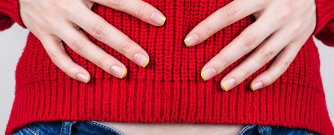 red sweater bloated woman