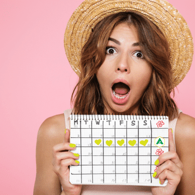Woman shocked while holding up a calendar with the Atrantil logo on it.