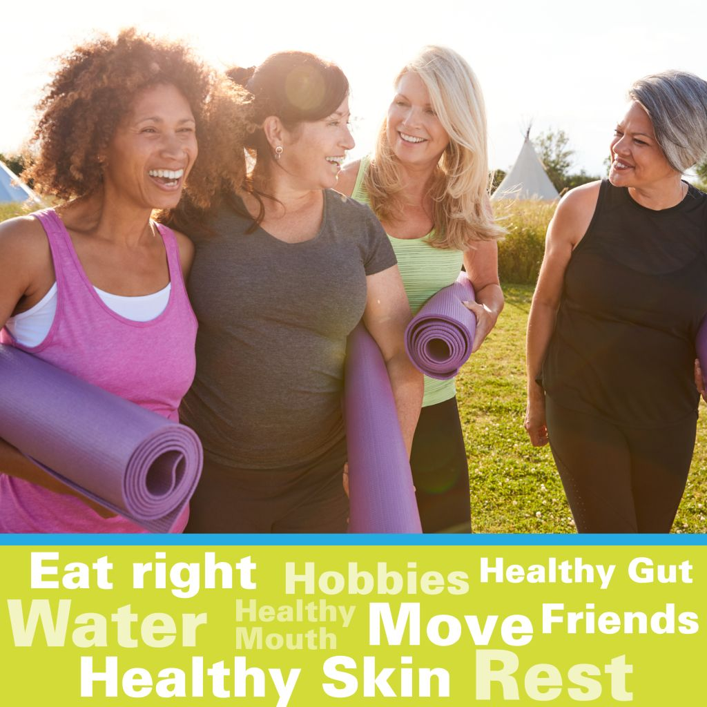 4 Women walking and talking with yoga mats